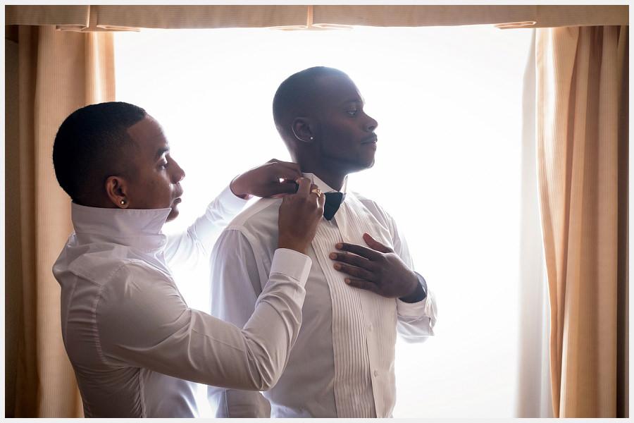 Helping the groom get dressed