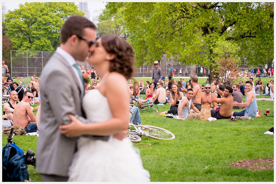 Bride and Groom and a crowd at Trinity Bellwoods Park