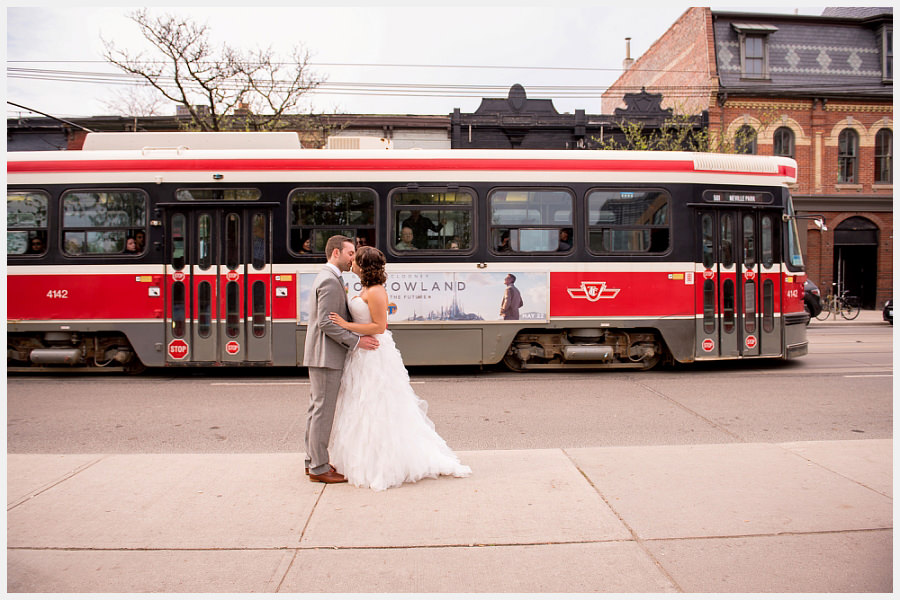 Bride and Groom with street car on the streets of Toronto